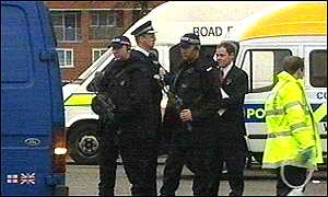 Armed officers carry out one of the stop checks