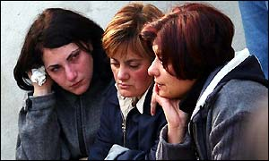 Three women weep after the earthquake