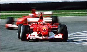 Michael Schumacher leads Rubens Barrichello at the 2002 US Grand Prix