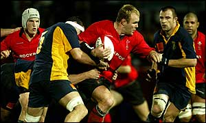 Scott Quinnell bursts past Romania's Christian Petre