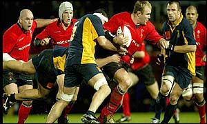 Wales number eight Scott Quinnell leads a Welsh charge in a frantic start to the second half