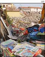 Salvaged books at the site of the school