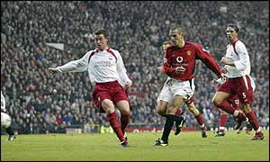 Phil Neville puts Man Utd ahead