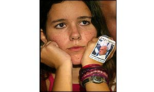 Israeli girl with a sticker showing Rabin on her hand (AFP)