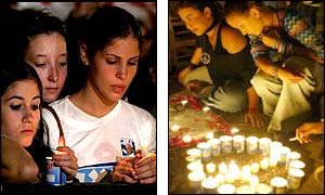 Israeli girls hold candles or sit by candles set out in the shape of a peace symbol (AFP-AP)