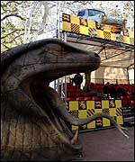 A giant snake's head and flying car at the Harry Potter premiere