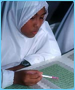 Muslim girl studying the Koran
