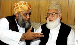 Maulana Fazlur Rehman (L) and Qazi Hussain Ahmed (R) meeting in Islamabad