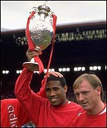 John Barnes lifts the League trophy in 1988