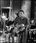 Jon Pertwee trying his hand at Skiffle. Adam Faith is on the left with guitar. From BBC show Six Five Special