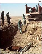 UN weapons inspectors destroying sarin gas rockets in Iraq