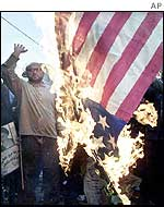Iranians burn a US flag