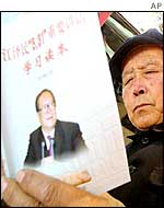 A Chinese man reads a book about an important speech by Chinese President Jiang Zemin