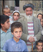 Gulam Sakhi, 83, with his grandchildren
