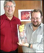 Russell Merryman (R) and Cliff Wootton (L) accept the award