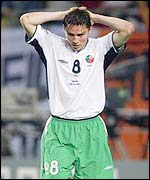 Ireland's Matt Holand reacts to his penalty miss against Spain the the last 16 of the World Cup