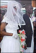 Bride wearing mosquito net dress