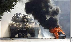 Israeli tank and burning tyres in Nablus, West Bank