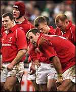 Wales players hang their heads after a heavy defeat last year