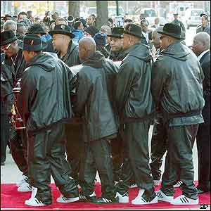 Pallbearers carrying the casket of Jam Master Jay