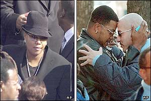 Rap singer Queen Latifah (left) and two mourners embrace head-to-head before entering the cathedral