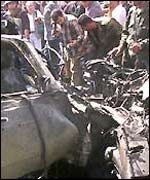 Wreckage of a car after an Israeli air raid in Gaza