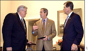 President George W Bush with House Speaker Dennis Hastert (l) and Senate Republican leader Trent Lott