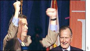Florida Governor Jeb Bush celebrates with his father
