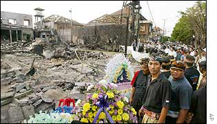 Balinese residents look at site of the destroyed Sari nightclub