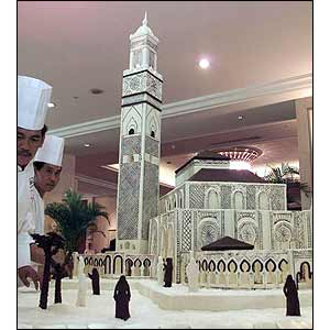 Indonesian chefs put the finishing touches to a 2.6 meter cake depicting the Hassan II mosque in Morocco  (AP)