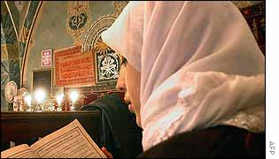 A Turkish girl reads the Koran at the Hadji Bayram mosque in Ankara