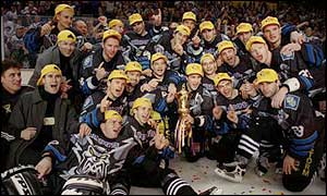 Manchester Storm celebrate winning the 1999 Benson and Hedges Cup