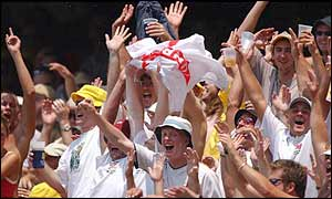 England's barmy army celebrate the wicket of Langer