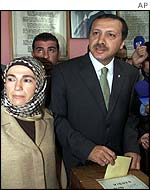 Erdogan with wife at polling station