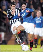 Rangers Mikel Arteta (right) holds off Dunfermline's Gary Dempsey