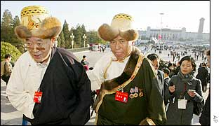 Two Tibetan delegates walk up the steps of Beijing's Great Hall of the People as they arrive for the opening session of the 16th  Chinese Communist Party Congress 8 Nov 2002.