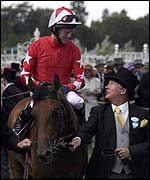 Mick Kinane on Rock of Gibraltar is congratulated by co-owner Sir Alex Ferguson after winning at Royal Ascot