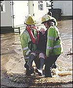 firefighters rescuing trapped resident