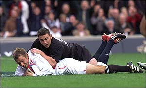 Jonny Wilkinson goes over to score England's second try