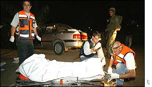 Rescue workers with the body of a victim of the gunman