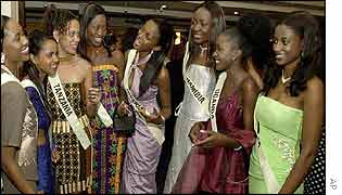 Miss Nigeria Chinenye Ivy Ochuba (centre) with other contestants at a Gala in London  on November 10