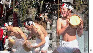 Men splash themselves with icy water in Japan
