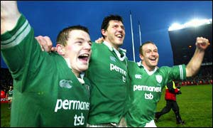 Brian O'Driscoll celebrates with Shane Horgan and Denis Hickie