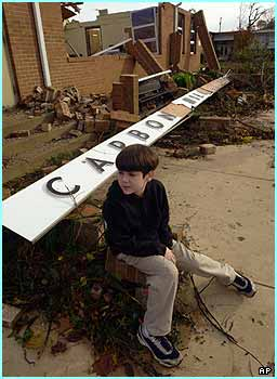 Johnny Rosales sits in front of what used to be his primary school in Alabama