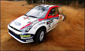 Colin McRae kicks up some dust during the Rally Australia