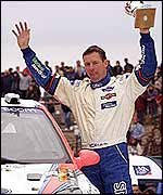 Colin McRae celebrates after another victory