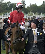 Sir Alex Ferguson guides Rock of Gibraltar into the winner's enclosure at Royal Ascot
