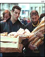 Calais residents bring bread to the church