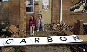 Children sit on the steps of their destroyed school in Carbon Hill, Alabama