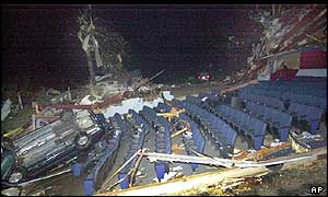 Car lies upside down in auditorium of wrecked cinema, Van Wert, Ohio